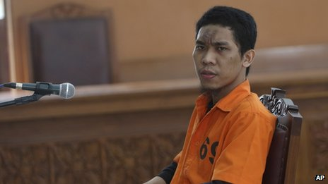 Separiano sits in the defendant's chair during his trial at the South Jakarta District Court