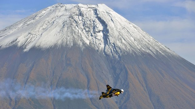 Jetman flying past Mount Fuji