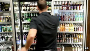 Man at fridge containing alcohol