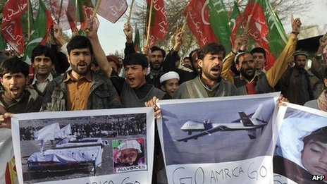 Supporters of Pakistani cricketer turned politician Imran Khan of Pakistan Tehreek-i-Insaaf (PTI - Movement for Justice) hold placards as they shout anti-US slogans during a protest in Islamabad on January 27, 2012, against US drone attacks