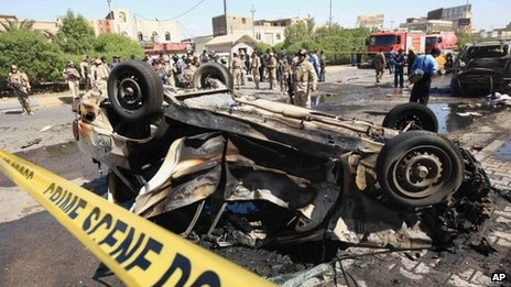 Aftermath of a bombing in the Iraqi city of Basra on 13 October 2013