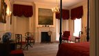 A grand bedroom, following restoration.