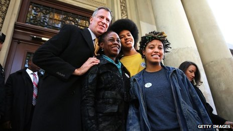 New York Democratic mayoral candidate Bill de Blasio poses with his family, wife Chirlane McCray, son Dante de Blasio and daughter Chiara de Blasio after voting at a New York  public library branch on Election Day 5 November 2013
