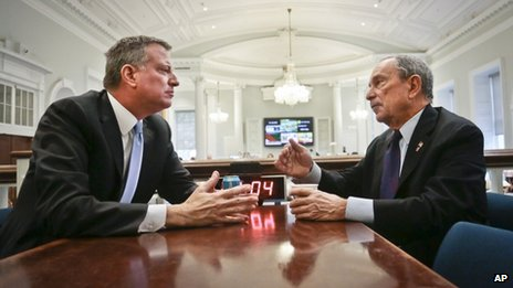 "New York City Mayor-elect Bill de Blasio, left, join Mayor Michael Bloomberg for a meeting in the ""Bull Pen,"" the mayor's main City Hall office 6 November 2013"