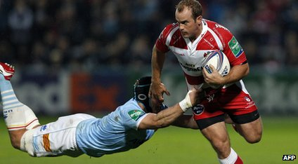 Gloucester's wing James Simpson-Daniel tries tobreak a tackle from USA Perpignans Luke Narraway