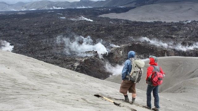 Researchers watch the obsidian flow at Cordon Caulle volcano in Chile