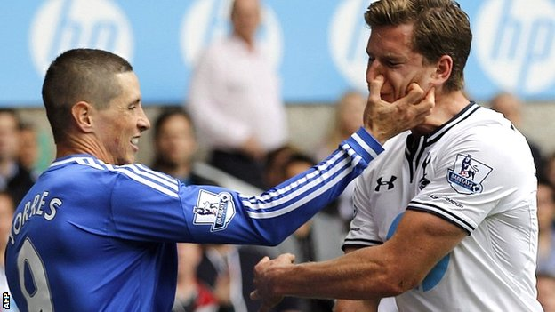 Chelsea's Fernando Torres clashes with Jan Vertonghen of Tottenham