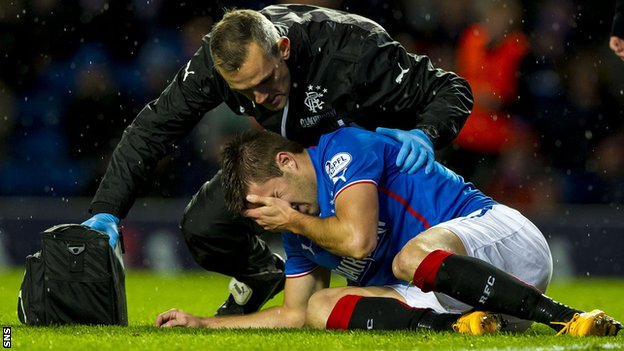 Rangers forward Andy Little receives treatment after being injured against Dunfermline