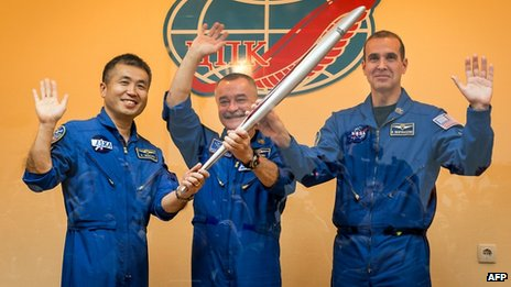The crew with the Olympic torch