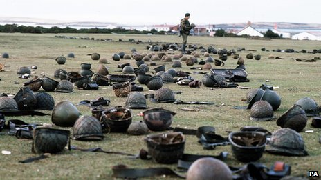 The ground where over 1,200 Argentinian soldiers surrendered to British forces and laid down their arms. The ground is littered with helmets, weapon magazines, ammunition and water bottles