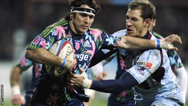 Stade Francais' Gonzalo Tiesi (left) fends off Bourgoin's David Janin