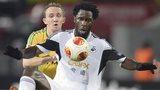 Kuban defender Aleksei Kozlov (L) challenges Swansea goal-scorer Wilfried Bony