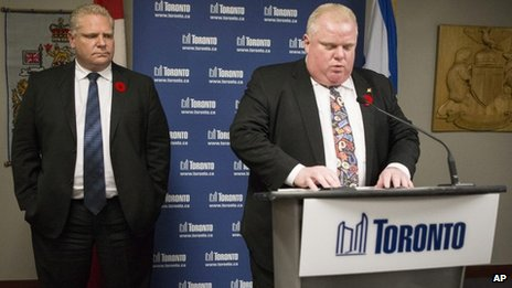 Toronto Mayor Rob Ford addresses the media at City Hall as his brother city councillor Doug Ford, left, looks 5 November 2013