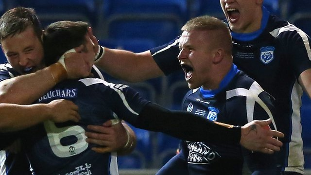 Alex Russell celebrates scoring a try against USA