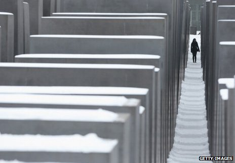 A woman walks through the Berlin Holocaust Memorial