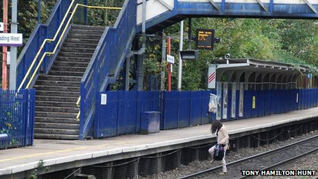 A woman crossing the track at Reading West Station