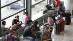 Stranded passengers wait at the lobby of Ninoy Aquino International airport in Pasay city, metro Manila, 8 November 2013