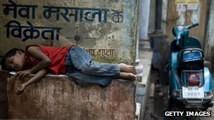 Indian child sleeps in the street
