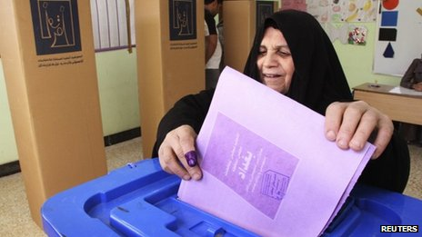 A woman votes in the April 2013 provincial elections in Baghdad