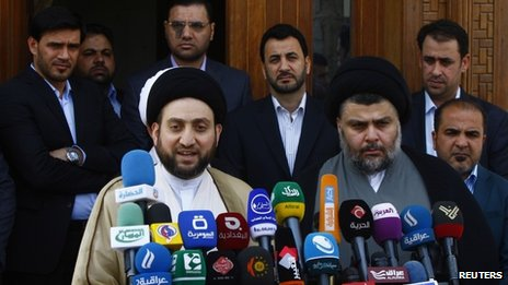 Ammar al-Hakim, leader of the Islamic Supreme Council of Iraq, and Moqtada Sadr address reporters in Najaf (8 May 2013)