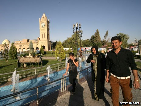 People walk in Irbil