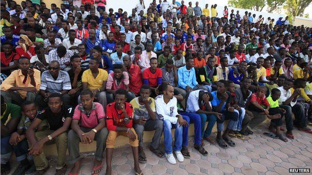 Spectators watch the first soccer match of the Somalia Premier League between Heegan and Gaaddidka at the Banadir stadium in Mogadishu (8 November 2013)