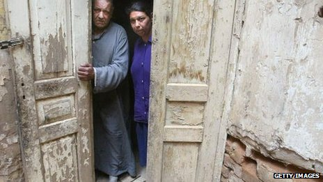 Jakob Yusef and Khalda Salih standing in a doorway