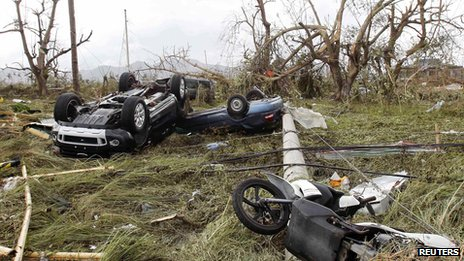 Cars swept into a rice field in Tacloban. 9 Nov 2013