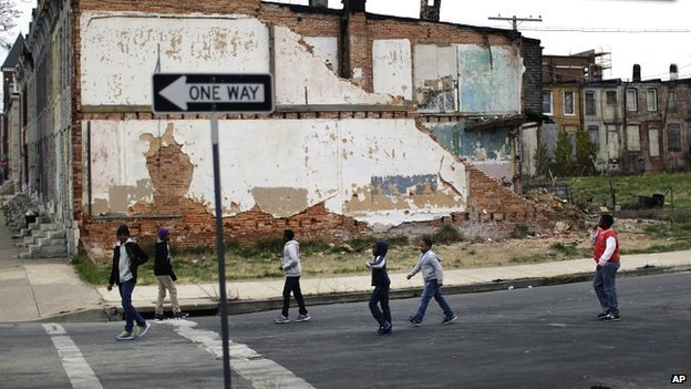 Children playing near derelict houses in Baltimore