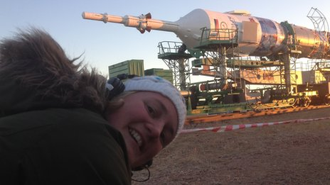 BBC camerawoman Rachel Price with Soyuz rocket in background