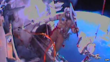 mr oleg kotov Russian iss-38 crew members oleg kotov and sergey ryazansky  work  outside the iss the cosmonauts installed hr and mr cameras onto.