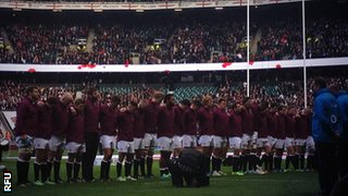 England players respect a minutes silence at Twickenham