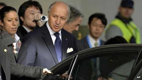French Foreign Minister Laurent Fabius leaves the hotel, on the third day of closed-door nuclear talks with Iran at the United Nations offices in Geneva on 9 November