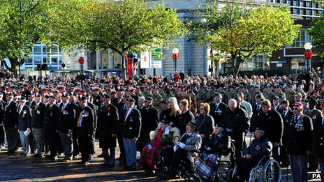 Members of the Armed Forces and veterans stand at Centenary Square, Birmingham, during a Remembrance Sunday service
