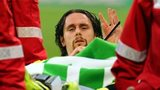 Borussia Dortmund defender Neven Subotic is carried off on a stretcher against Wolfsburg