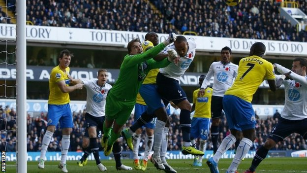 Newcastle United's Tim Krul (third left) punches the ball clear from Tottenham Hotspur's Younes Kaboul
