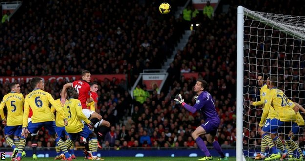 Robin van Persie scores Manchester United's winning goal against Arsenal