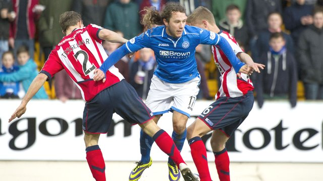 St Johnstone striker Stevie May slips between two Kilmarnock players