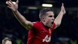 Manchester United striker Robin van Persie celebrates after scoring