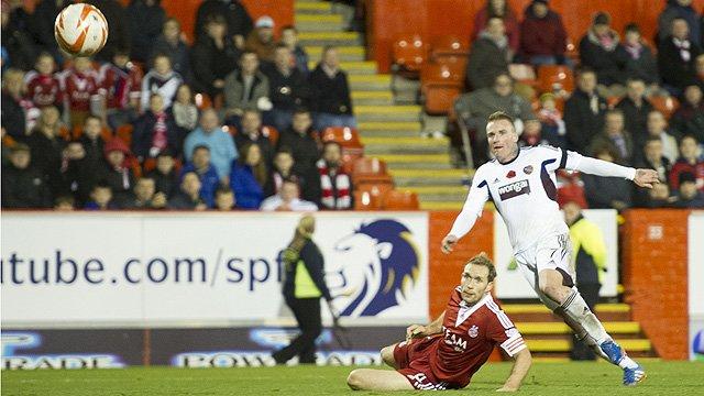 Ryan Stevenson scores Hearts' third goal at Aberdeen