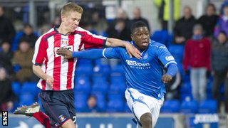 St Johnstone striker Nigel Hasselbaink holds off Kilmarnock's Mark O'Hara