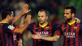 Barcelona players celebrate scoring against Real Betis