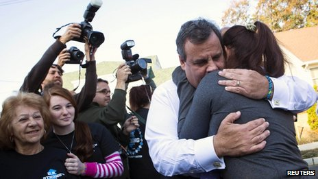 New Jersey Governor Chris Christie hugs a resident on the one-year anniversary of Hurricane Sandy in Union Beach, New Jersey October 29, 2013