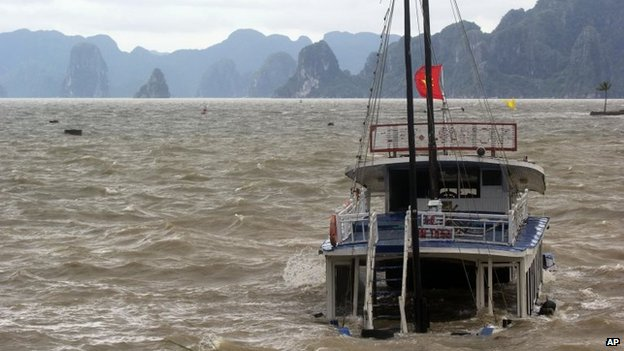 A tourist boat is seen sinking in Ha Long Bay, Vietnam on 11 November 2013