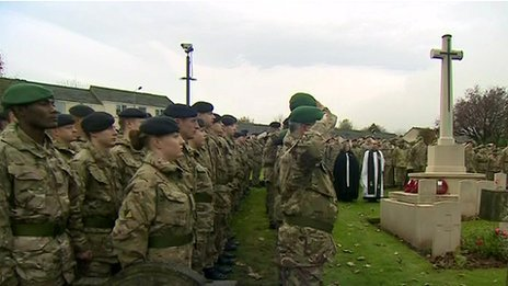 Soldiers at Catterick Garrison Cemetery, north Yorkshire, observe a silence
