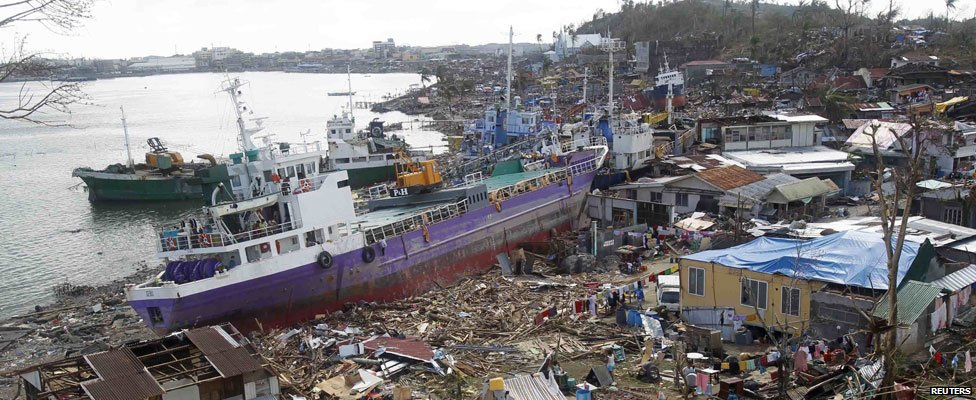 From ground level - Cargo ships washed ashore are seen four days after super typhoon Haiyan hit Anibong town, Tacloban city