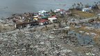 This aerial photo shows destroyed houses in the city of Tacloban, Leyte province, in the central Philippines on 11 November 2013