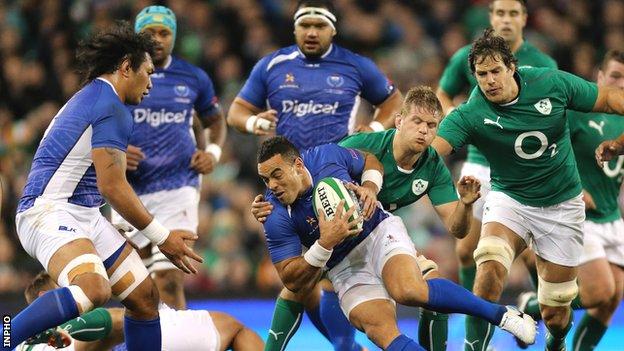 Chris Henry tackles Samoa's Kahn Fotuali'i on Saturday