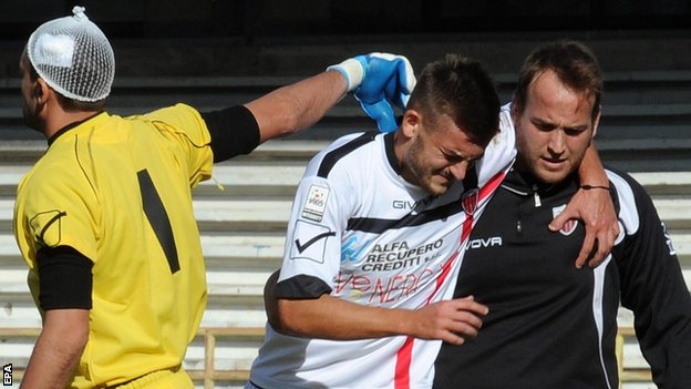 A Nocerina player goes off injured against Salernitana