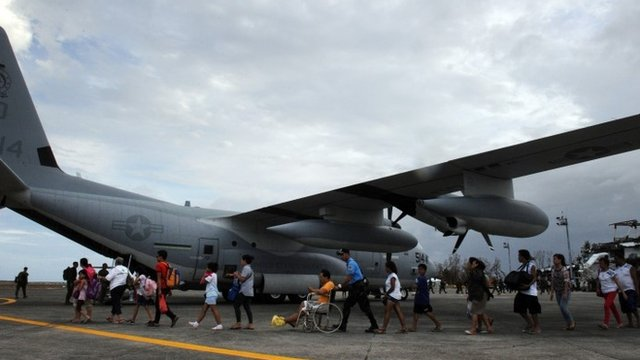 Survivors of Super Typhoon Haiyan board plane